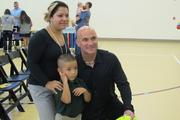 Agassi poses with fans at the event.