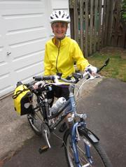 "REI's Karen Meyer said of this photo, ""Saddled up, ready to go. I love my ride."" All told, REI features six Bike Commute Challenge teams from its stores in the Portland area and Bend. Those teams count 143 riders. The event runs through September."