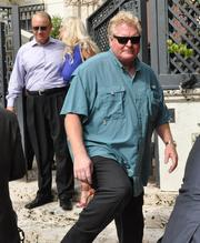 Peter Loftin, who owned the mansion for years, leaves after the auction. He put the ownership company into bankruptcy after it was beset by lawsuits.