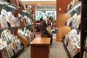 Anthony Hopson reads a magazine at Booksellers on Fountain Square.