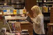 Sam Kuchera browses books at Booksellers on Fountain Square.