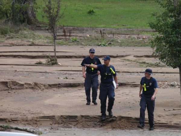 FEMA's Urban Search and Rescue conducts door-to-door checks in Left Hand Canyon on Monday.