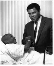 Muhammad Ali drops by PCH to visit a patient in this undated photo.