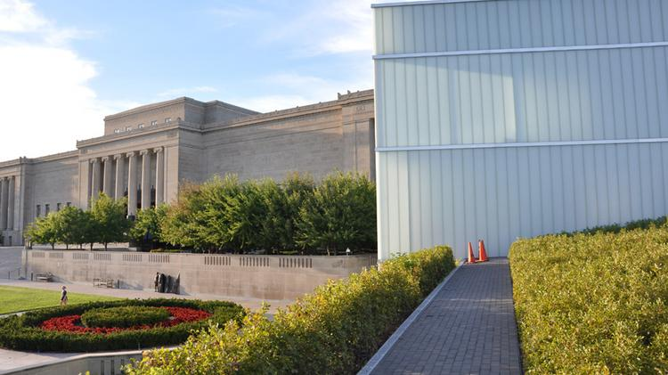 The $200 million, 165,000 square-foot addition to the Nelson-Atkins museum is a series of five recessed buildings built into the east side of the campus of the 1930's Beaux Arts-style art museum.