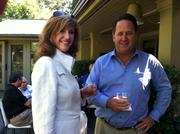 Susan Hutchison and Kevin Callaghan celebrate at Sept. 11 presentation of Telly award to Bill Boeing Jr. at Boeing's home.