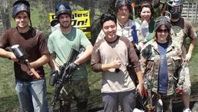 Employees at Quintiq enjoy a day playing paintball.