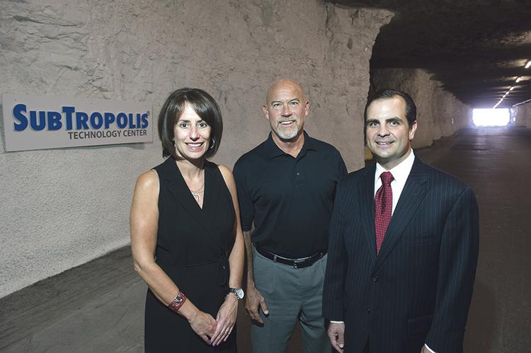 Jim Masterson, CEO of LightEdge Solutions Inc., is flanked by Ora Reynolds and Mike Bell of Hunt Midwest Real Estate Development.