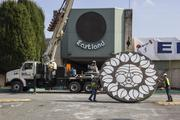 """The final """"Rising Sun"""" sign is pulled from Eastland Mall and prepared for transport to a storage facility in Concord."""