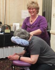 No. 8 (Companies 2-99): Susan Riddles gets a seated massage at a health fair for Corporate Network Services employees.