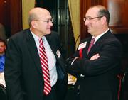 Conemaugh Health System's John Moryken, left, and panelist Michael Strazzella of Buchanan Ingersoll & Rooney.