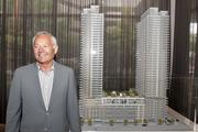 Nat Bosa, president of Bosa Development, stands by the model of Insignia with two towers. The company decided to go ahead with the second tower; construction is already under way on the first one.