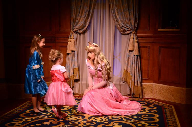 Princess Aurora, aka Sleeping Beauty, holds court with some aspiring royalty at a Princess Fairytale Hall preview. The attraction opened Sept. 18.