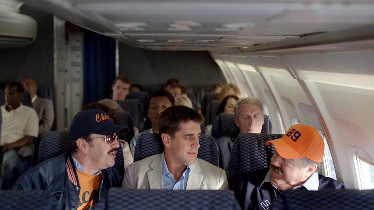 Green Bay Packers quaterback Aaron Rodgers finds himself squeezed into grill class on board this flight.
