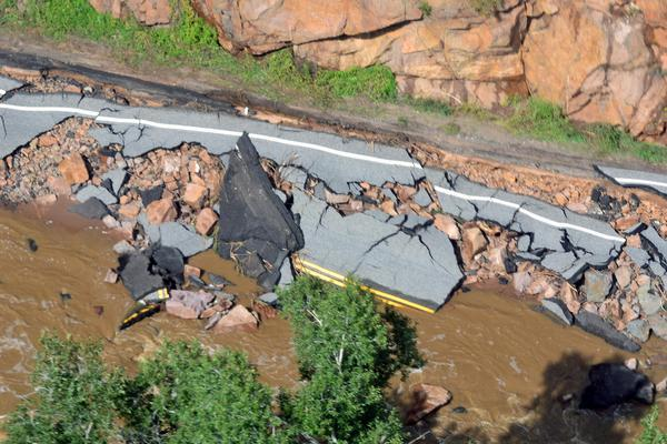 Flooding destroyed this roadway in Boulder County, Colo.