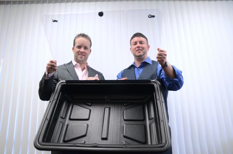 From left: Justin and Jarad King with one of their TV shields
