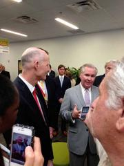 Gov. Rick Scott with Tampa Mayor Bob Buckhorn at an event at 6700 Lakeview Center Drive, a corporate office complex. At the event it was announced that HealthPlan Services, a subsidiary of HealthPlan Holdings, will add 1,000 jobs and expand its headquarters in a 100,000-square-foot facility.