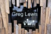 """The name of Greg Lewis appears at one section of his art installation """"Boxed Up"""" on Seattle's Capitol Hill. The installation is part of a partnership between Storefronts Seattle and Stream Real Estate and is to remain on site until the old building is demolished in February 2014."""