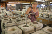 Therasa Arrison Howard fills casting molds for Able Brewing coffee pots