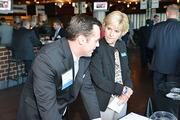 Fran McKeever with an attendee at the Philadelphia Business Journal's Best Places to Work event at the Wells Fargo Center.