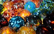 A colorful pile of glass or friendship balls is seen at Girl Glass Studio.
