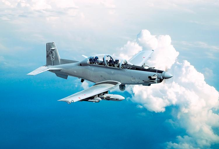 Beechcraft and Textron are also working on cost-conscious defense offerings —Beechcraft's propeller-driven AT-6 (pictured) and Textron's Scorpion fighter jet — and combining them could help Textron corner two segments of the defense market.