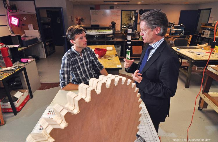 """""""Why don't more of our ideas make it into commercialization? A lot of it is a clunky tech transfer system,"""" says Laban Coblentz, right, founder and chairman of the Tech Valley Center of Gravity. Here, he works with volunteer and 2013 Rensselaer graduate John Grube at the Troy incubator."""