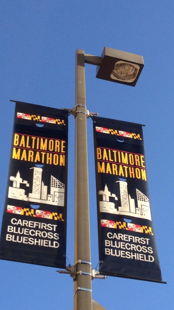 A street lamp banner downtown promotes the Baltimore Running Festival.