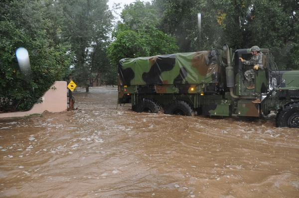 A National Guard truck negotiates flood waters in Boulder County in September.