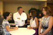 Local professionals network during the reception.