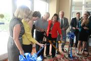 The event's VIPs cut the ribbon for the new Gary Sain Memorial Skybridge.