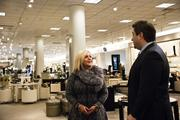 Nordstrom store manager Lori Stein talks with shoe department manager Sean Ekl.