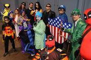 A group of costumed fans pose as they wait in line to sign up for the costume contest.