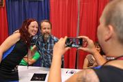 SplinterCat, of the Black-n-Bluegrass Rollergirls, poses as a friend takes a photo of her with actor Billy Boyd, who played Pippin in Lord of the Rings.