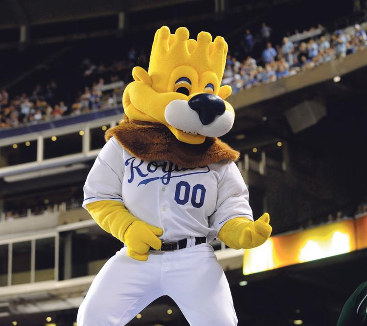 """Slugger,"" the mascot of the Kansas City Royals, plays an ""air guitar"" on the opposing team's dugout during a break in the action of the June 1 game against the Los Angeles Angels."