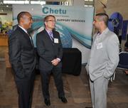 David Andrade and Chuck Ruzicka of Centric Consulting talking to Abdul Malik of Synechron.