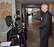 George Labelle of Independent Purchasing Cooperative looks at the offerings for the silent auction.