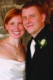 JULIE REID AND TRISTAN LIABRAATEN: They met and married while working at WaMu. When news broke of its bankruptcy, she was on maternity leave.