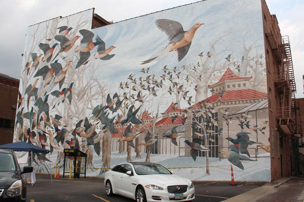 "The mural at 15 E. Eighth St. is titled ""Martha,"" commemorating the last passenger pigeon."