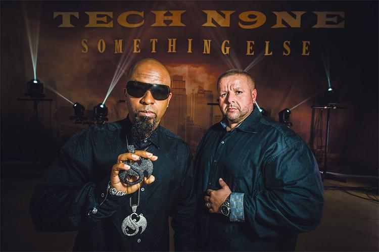 "Aaron ""TechN9ne"" Yates (left) and Travis O'Guin are now the largest independent hip-hop label in the world after forming Strange Music Inc. in 2000. Behind them is a backdrop from TechN9ne's current tour, and the art will be incorporated into a CD cover."