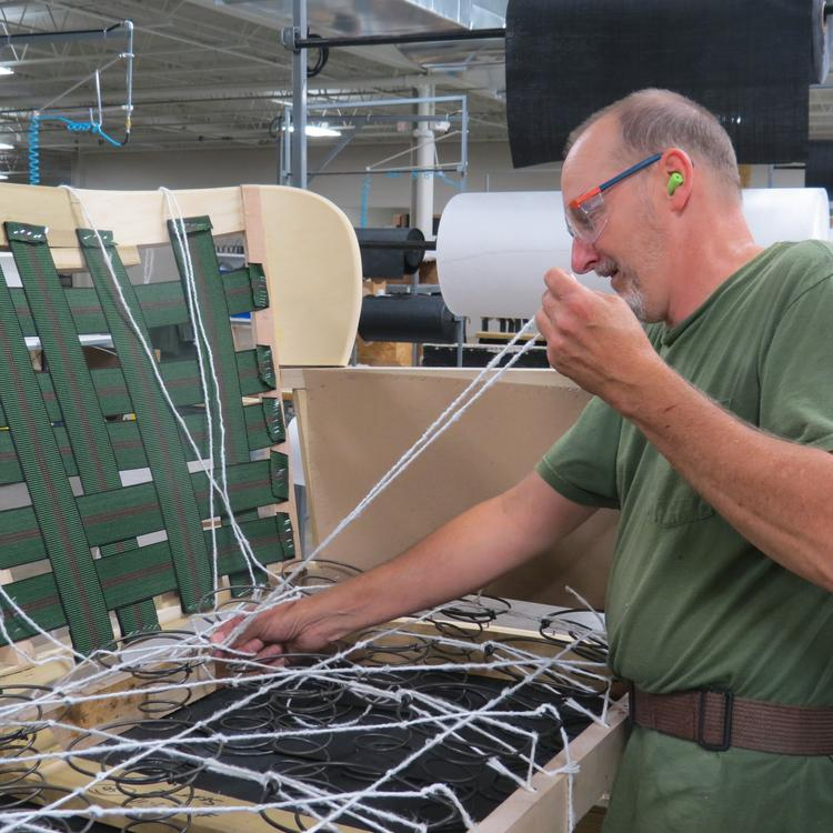 Johnny Deal of Lee Industries has been using the eight-way hand tie technique in sofa and chair springs for 25 years.