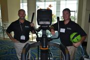 Fitness Resource brought some exercise equipment to the Healthiest Employers expo, including a medicine ball that has diagrams of workout routines printed on the ball. From the company, Monty Warsing, left, and Mike Pfatzgraf.