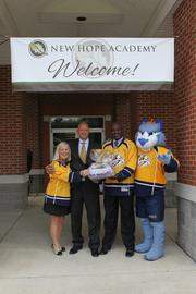 On August 19, the Nashville Predators Foundation and DEX Imaging, the largest and fastest growing independent document imaging dealer in the Southeast United States, presented donations of school supplies to New Hope Academy, Lighthouse Christian School and the Boys & Girls Clubs of Middle Tennessee as students begin the 2013-14 school year. These donations were collected by the Nashville Predators & DEX Imaging during their Back To School Collection Challenge throughout the month of July.  School supplies donation drop off at New Hope Academy with (from left) Cathy Irwin, Mark Blaze of DEX Imaging, Stuart Tutler and Nashville Predators Mascot Gnash.