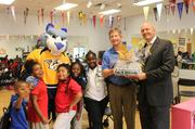 From left: Nashville Predators Mascot Gnash, Dan Jernigan of Boys & Girls Clubs of Middle Tennessee and Mark Blaze of DEX Imaging with Boys & Girls Clubs of Middle Tennessee