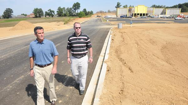 Before construction began on the now-finished Corky's on Goodman in Olive Branch, owners Barry Pelts and Andy Woodman survey the site. The new Malco, now open, is also under construction in the background.