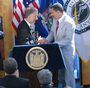 CNSE CEO Alain Kaloyeros also has worked with Gov. David Paterson, a Democrat.