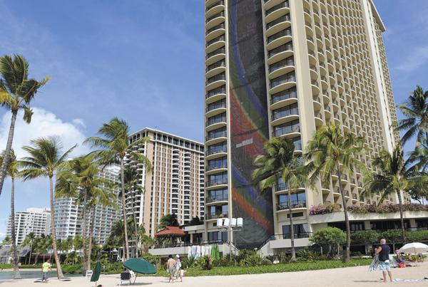 Hawaii hotels brought in a record $1.42 billion during the summer months, an 8.5 percent increase from last year. Seen in this file photo is the Hilton Hawaiian Village Waikiki Beach Resort.
