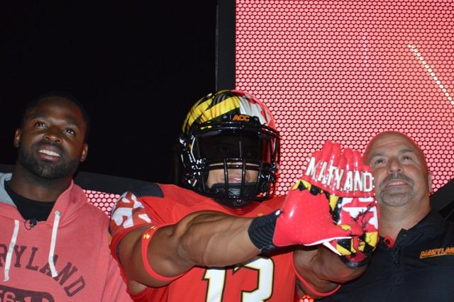 An Under Armour model shows off the new Maryland football gloves.