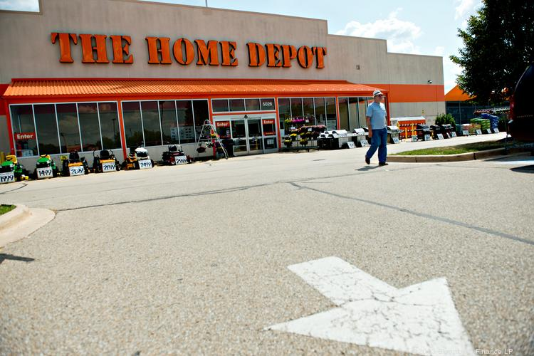 A shopper exits a Home Depot Inc. store in Peoria, Ill. Photographer: Daniel Acker/Bloomberg