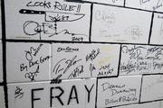 Anderson makes it a habit of asking visiting artists to sign the brick-lined hallways backstage at DPAC.