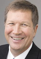 Gov. John Kasich says he's overall pleased with a state budget that provides an estimated net tax cut of $2.7 billion over the next three years.